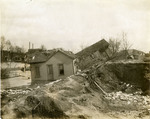 Houses lifted from foundations near Herman Avenue