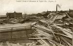 Flood ravaged lumberyard at Monument and Taylor Streets