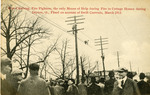 Fire fighters climbing telephone poles during flood