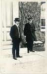 Brother Gorman & unknown man in front of St. Mary's Hall during flood (front) by University of Dayton