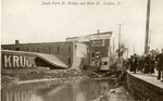 Damaged buildings and flood waters at South Park Street Bridge