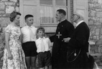Gilberte Degeimbre, her two sons, Rev. Debergh, and Rev. Gaston Maes