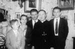 Gilberte Degeimbre family and Rev. J. Debergh, OMI