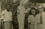 Albert Voisin and his wife, Yvonne, in the Belgian Congo in front of the statue of Our Lady of Beauraing, 1953