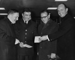 Albert Voisin, Fr. Debergh, Rev. Fillion, and Customs Officer at Airport, 1964