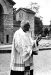 Canon Henry Massart, Rector of the Beauraing shrine, in front of the Votive Chapel, 1960