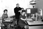 Rev. Joseph Debergh, O.M.I., Miss Doris M. Poisson, and Miss Ursula J. Belley in the second office of the Pro Maria Committee, 1964