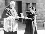 Ursula Belley Presents Chalice to the Rector of the Shrine, 1958