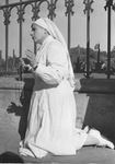 Nurse praying at Lourdes, circa 1950