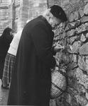 Woman Filling Water Jug at Lourdes, circa 1950