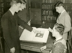 Bro. Stan Mathews with Patrons in the Marian Library, circa 1960