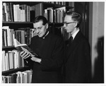 Fr. Hoelle and Fr. Maloy in the Marian Library, circa 1960