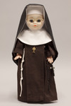 Doll wearing habit worn by Sisters of Saint Francis of Perpetual Adoration