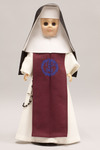 Doll wearing habit worn by Sisters of the Incarnate Word and Blessed Sacrament