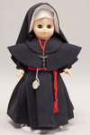 Doll wearing habit worn by Sisters of the Most Precious Blood