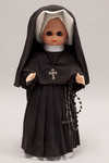 Doll wearing habit worn by the Sisters of Charity of Our Lady of Mercy
