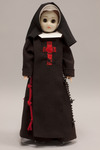 Doll wearing habit worn by Franciscan Sisters of the Poor  of Cincinnati, Ohio