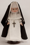 Doll wearing habit worn by Eucharistic Missionaries of Saint Dominic