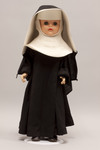 Doll wearing habit worn by an unidentified religious order