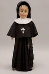 Doll wearing habit worn by Sisters of the Holy Family of Nazareth