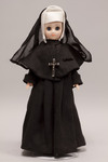 Doll wearing habit worn by Sisters of the Holy Names of Jesus and Mary