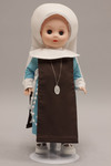 Doll wearing habit worn by Handmaids of Mary Immaculate
