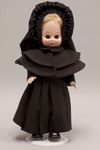 Doll wearing habit worn by Society of Saint Teresa of Jesus