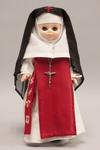 Doll wearing habit worn by Sisters Adorers of the Precious Blood