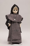 Doll wearing habit worn by Maryknoll Sisters of Saint Dominic