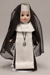 Doll wearing habit worn by Sisters of the Poor Child Jesus