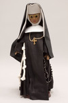 Doll wearing habit worn by Franciscan Handmaids of the Most Pure Heart of Mary