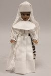 Doll wearing habit worn by a novice of the Sisters of the Holy Family