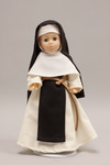 Doll wearing habit worn by Cistercian Sisters
