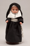 Doll wearing habit worn by Marianist Sisters