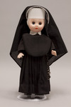 Doll wearing habit worn by Daughters of the Cross