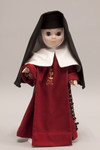 Doll wearing habit worn by Institute of Perpetual Adoration