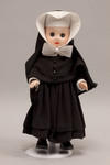 Doll wearing habit worn by Sisters of Christian Charity