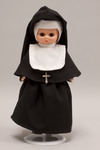 Doll wearing habit worn by Salesian Sisters of Saint John Bosco