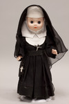 Doll wearing habit worn by Congregation of the Sisters of Our Lady of Mercy