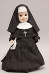 Doll wearing habit worn by Sisters of the Holy Family