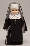 Doll wearing habit worn by Sisters of the Blessed Sacrament