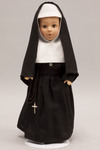 Doll wearing habit worn by Sisters of the Sorrowful Mother