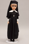 Doll wearing habit worn by Our Lady of Victory Missionary Sisters