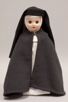 Doll wearing habit worn by Franciscan Missionaries of Mary