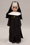 Doll wearing habit worn by Sisters of the Most Holy Sacrament