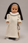 Doll wearing habit worn by Dominican Sisters