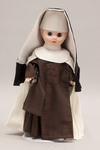 Doll wearing habit worn by Carmelite Sisters of the Divine Heart of Jesus