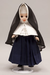 Doll wearing habit worn by Religious of the Sacred Heart of Mary