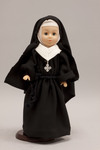 Doll wearing habit worn by Sisters of the Resurrection