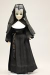Doll wearing habit worn by Sisters of the Presentation of the Blessed Virgin Mary